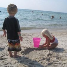 Boy walking toward girl on beach