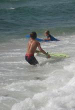 On boogie boards in the ocean