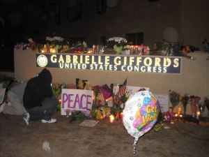 Leaving flowers outside Gabrielle Giffords' office