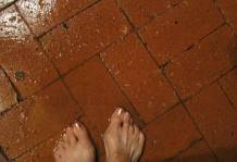Feet on a wet patio