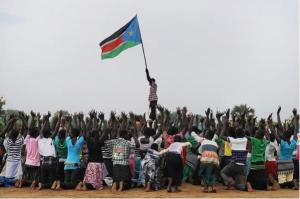 Crowd waving the flag of South Sudan