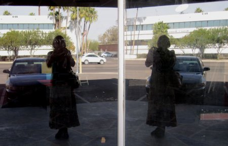 Alicja Mann's image twice in shop windows of Bohemia, Tucson, Arizona