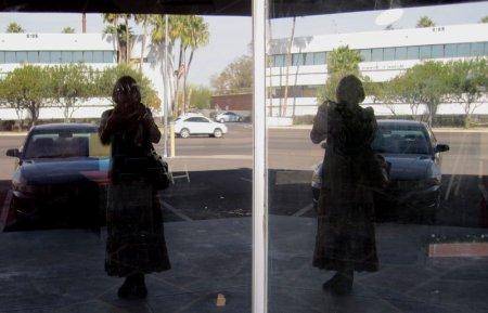 Alicja Mann's image twice in shop windows of Bohemia, Tucson, Arizona