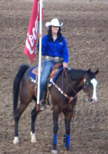 Horseback rider with Coca-Cola flag