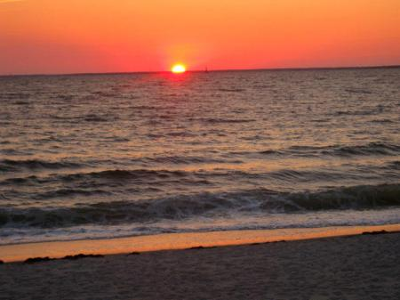 Sun at horizon, Silver Beach, Cape Cod, Massachusetts