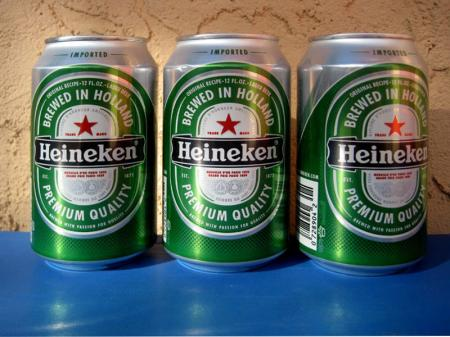 Three Heineken beer cans