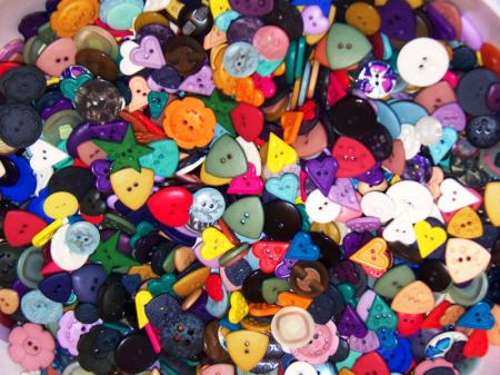 Ppiles of colorful buttons among them in the shape of heart