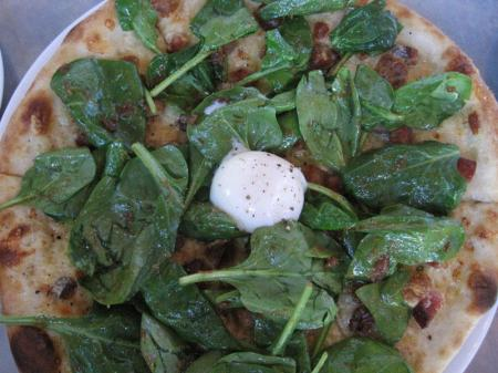 Pizza topped with spinach
