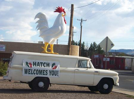 Huge Rooster mounted on  white truck