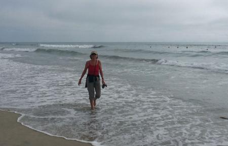 Author of the post walking on the line where ocean meets the sand