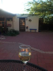 Patio on the end of the day.Glass of wine on the patio's table
