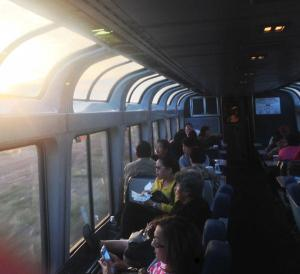 People looking out train windows
