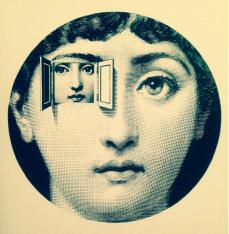 A decorative ceramic plate by Fornasetti